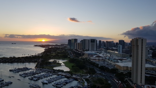Watching the sunset over Waikiki from our hotel room.
